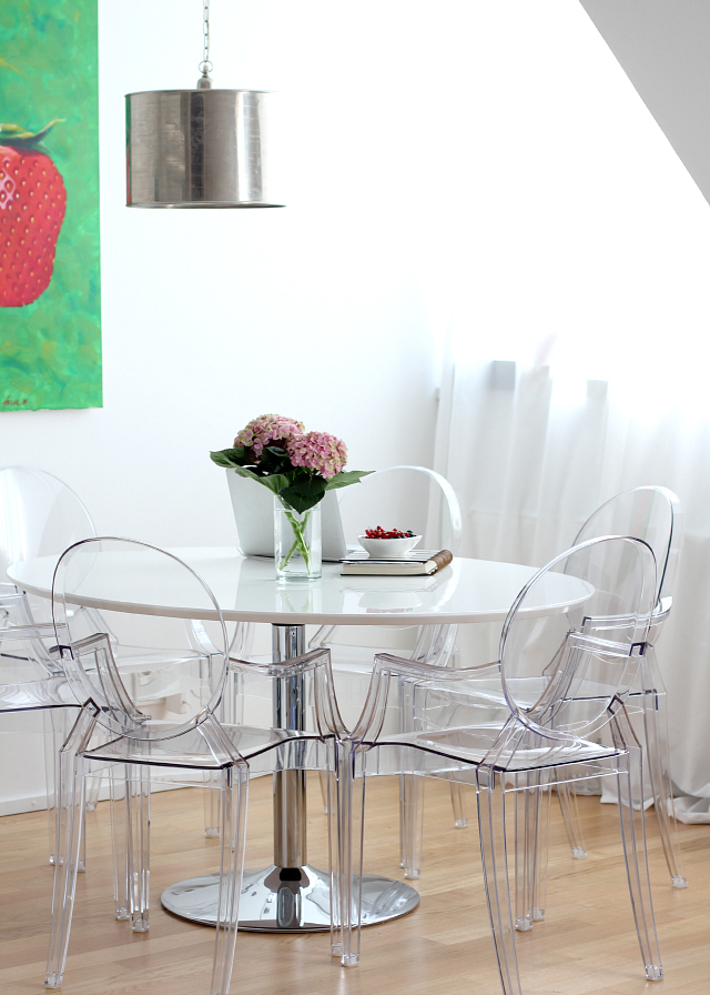 dining area in all white + louis ghost chair