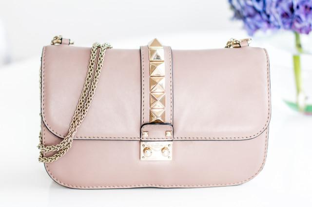 VIDEO: what's in my Valentino medium lock bag   Bikinis & Passports